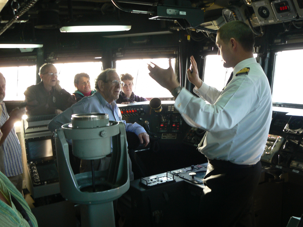 Kiama Rotary visit HMAS SYDNEY and are guided by the Commanding Officer